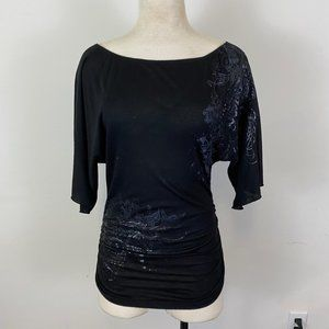 Black top with scrunch sides and printed designs